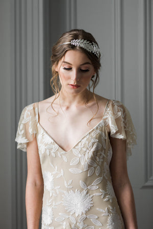 Bride wearing a silver leaf headband