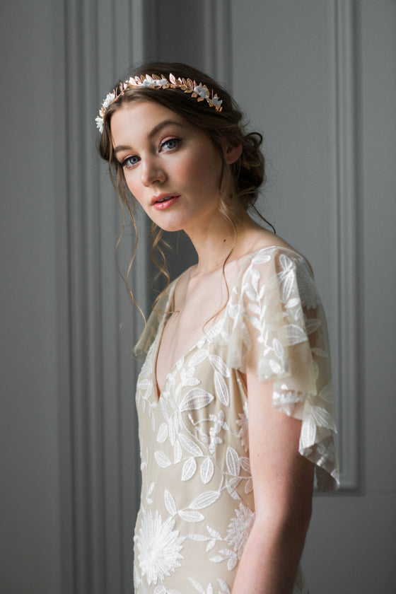 Bride wearing a rose gold crown with silk flowers
