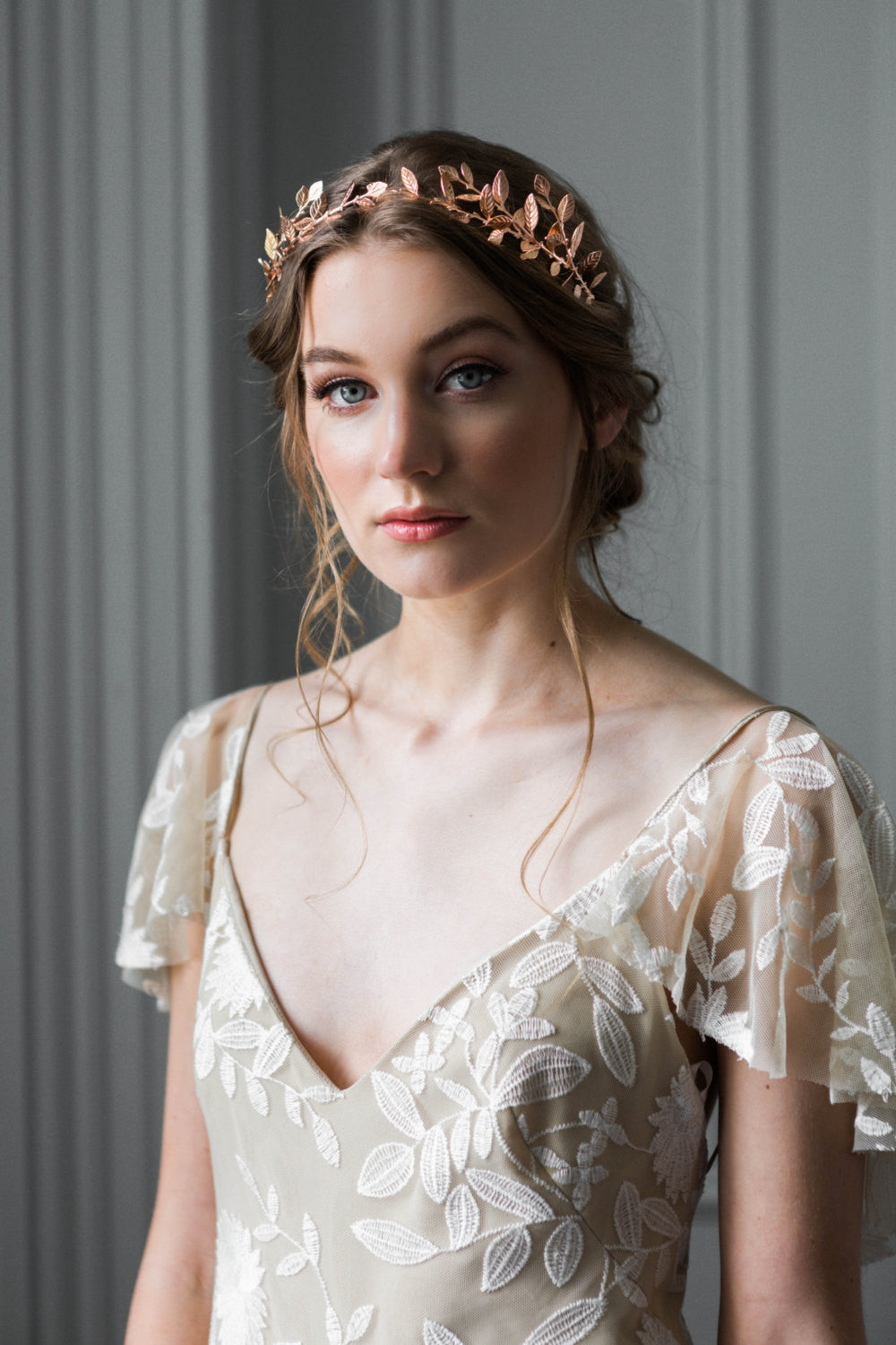 Bride wearing a delicate rose gold leaf tiara