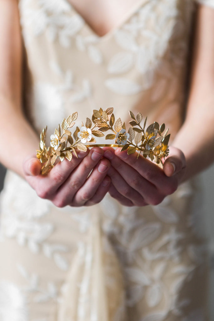 Bride holding a gold laurel leaf flower crown