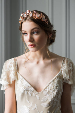 Bride wearing a rose gold laurel leaf flower crown