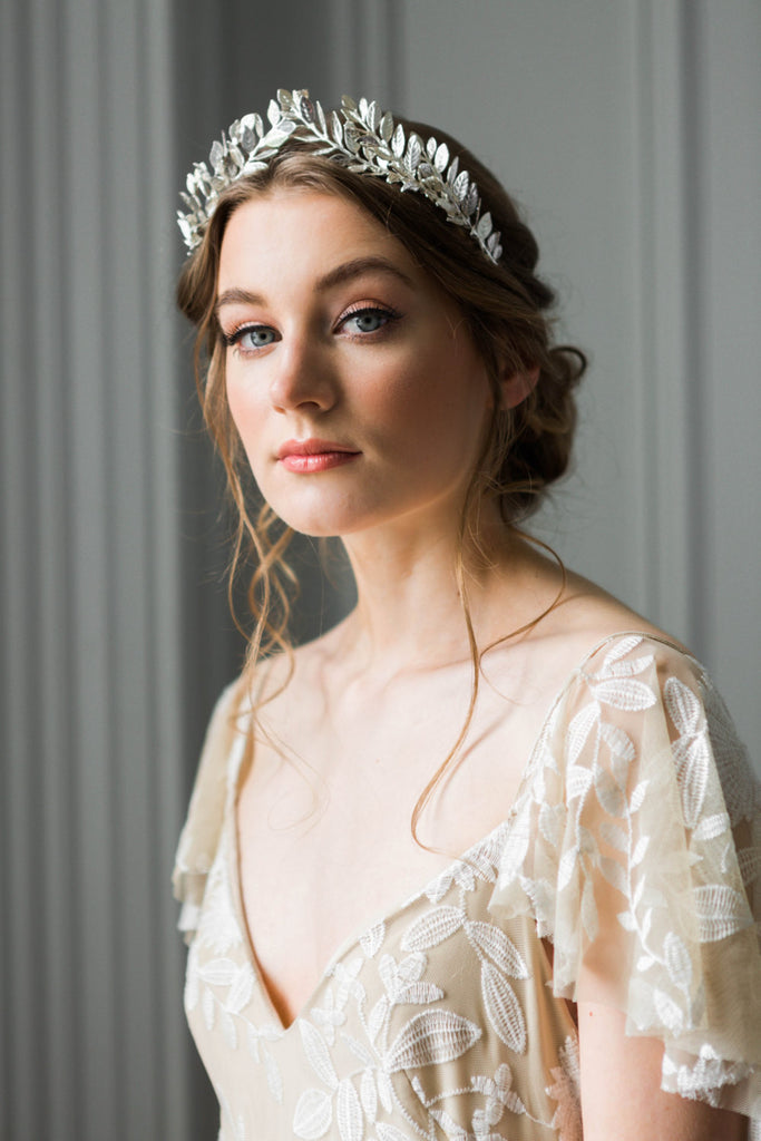 Bride wearing a silver laurel leaf tiara