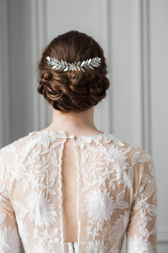Bride wearing a silver leaf comb in an up do