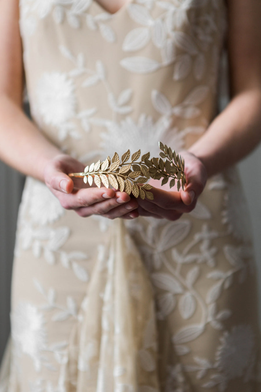 Bride wearing a gold leaf headpiece