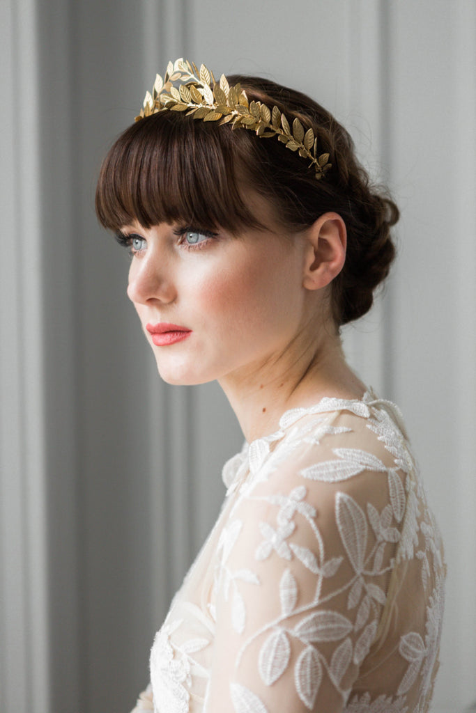 bride in a wedding dress wearing a gold leaf tiara