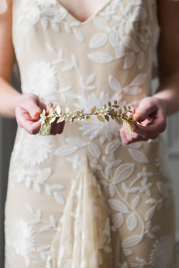 Bride wearing bridal headpiece made of gold vines