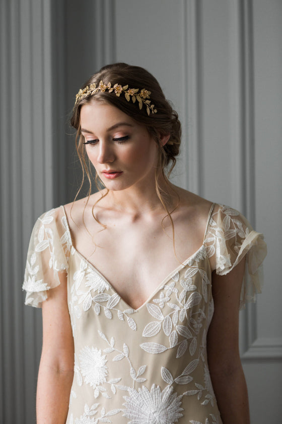 Bride wearing a gold leaf vine headband