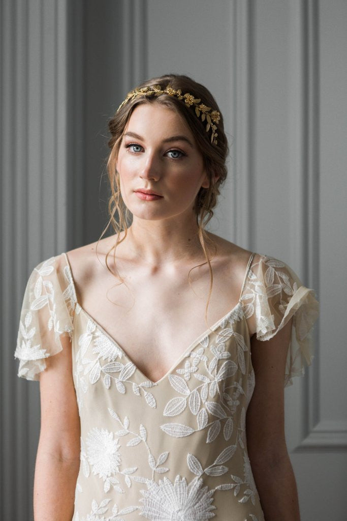 Bride wearing a gold leaf bridal tiara
