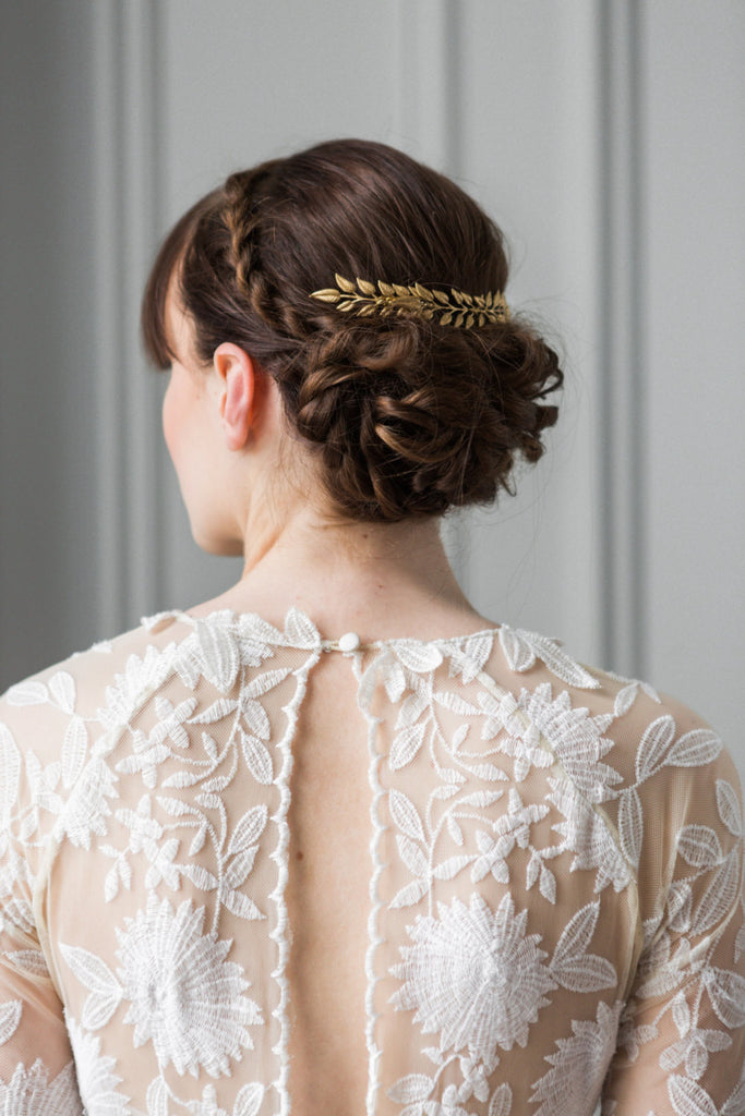 A bride wearing a bridal comb with gold edwardian leaves
