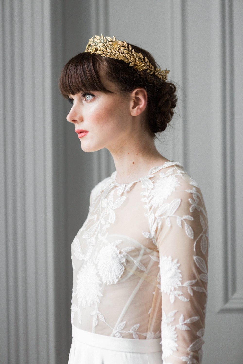 Bride wearing a gold leaf bridal crown