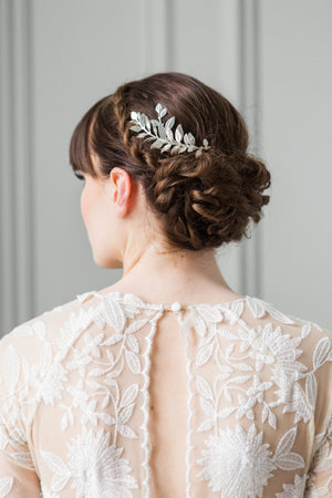 Bride wearing a silver leaf tiara in her hair