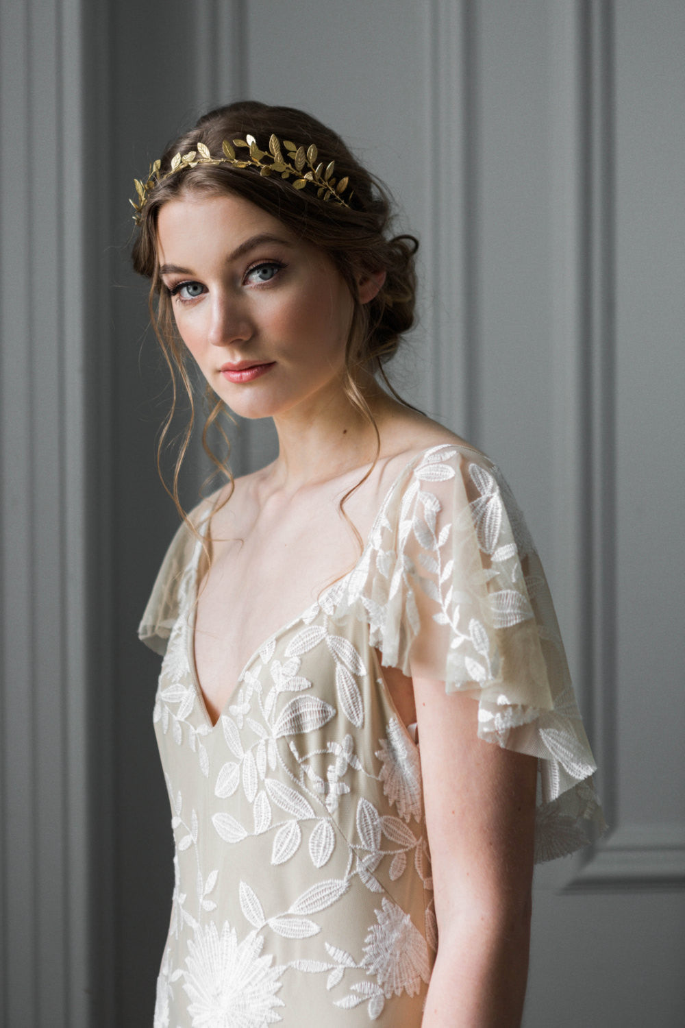 A bride wearing a delicate gold leaf tiara