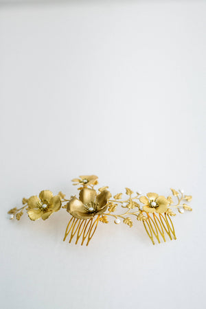 Close up of a bridal headpiece made of gold leave and flowers