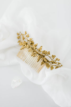 Close up of a hair comb headpiece made of gold leaves