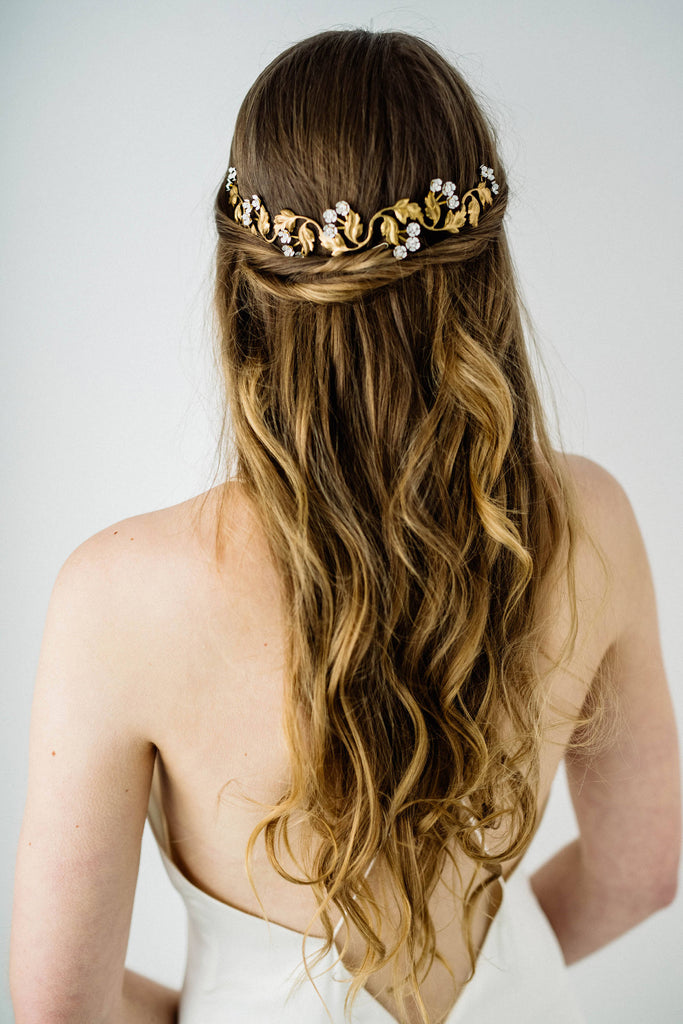 Model in wedding dress wearing gold bridal tiara