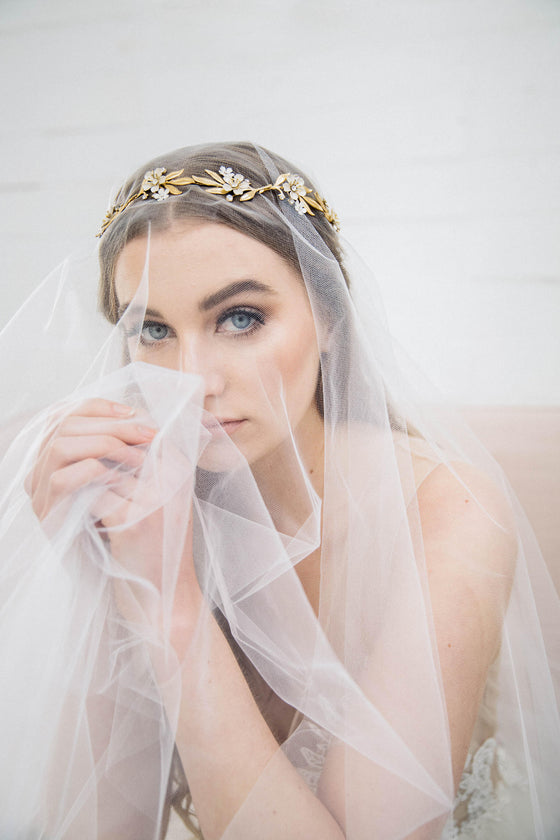 Bride wearing a gold tiara under a veil