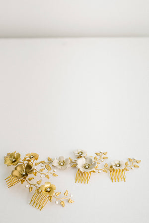 Close up of a bridal headpiece made of gold leave and ivory flowers