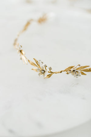 Close up of a gold and crystal bridal tiara