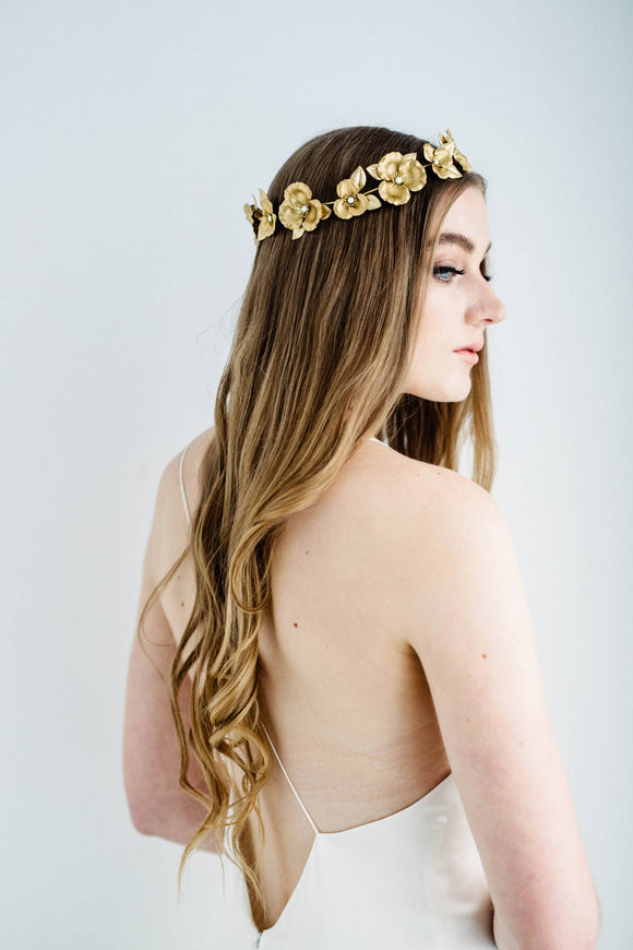 Bride wearing a circlet crown made of gold flowers