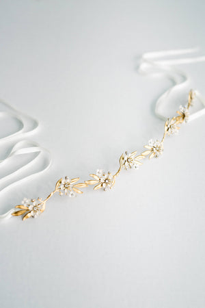 Gold leaf sash on white backdrop