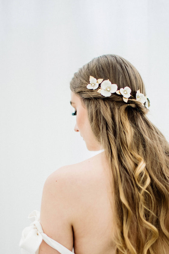 Bride wearing a wrap headpiece made of ivory flowers