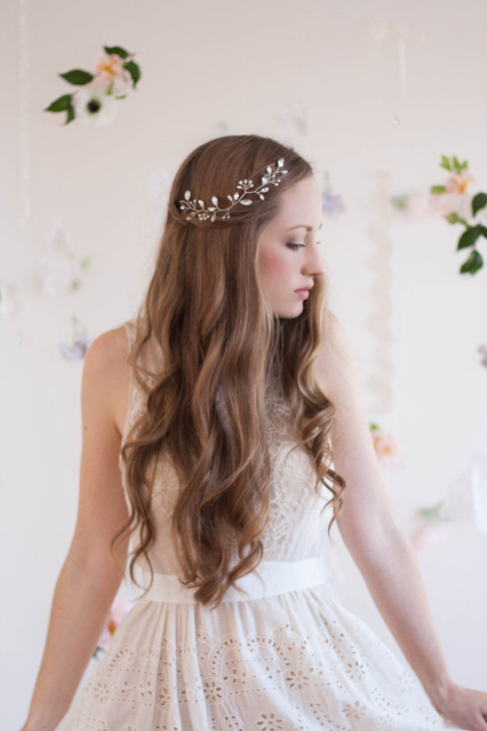 Bride wearing a vine hair piece made of crystals.