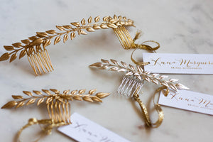 a close up of three edwardian leaf combs