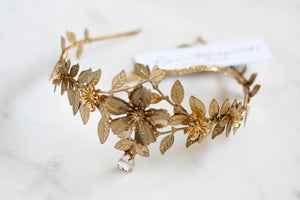 Close up of a gold leaf tiara