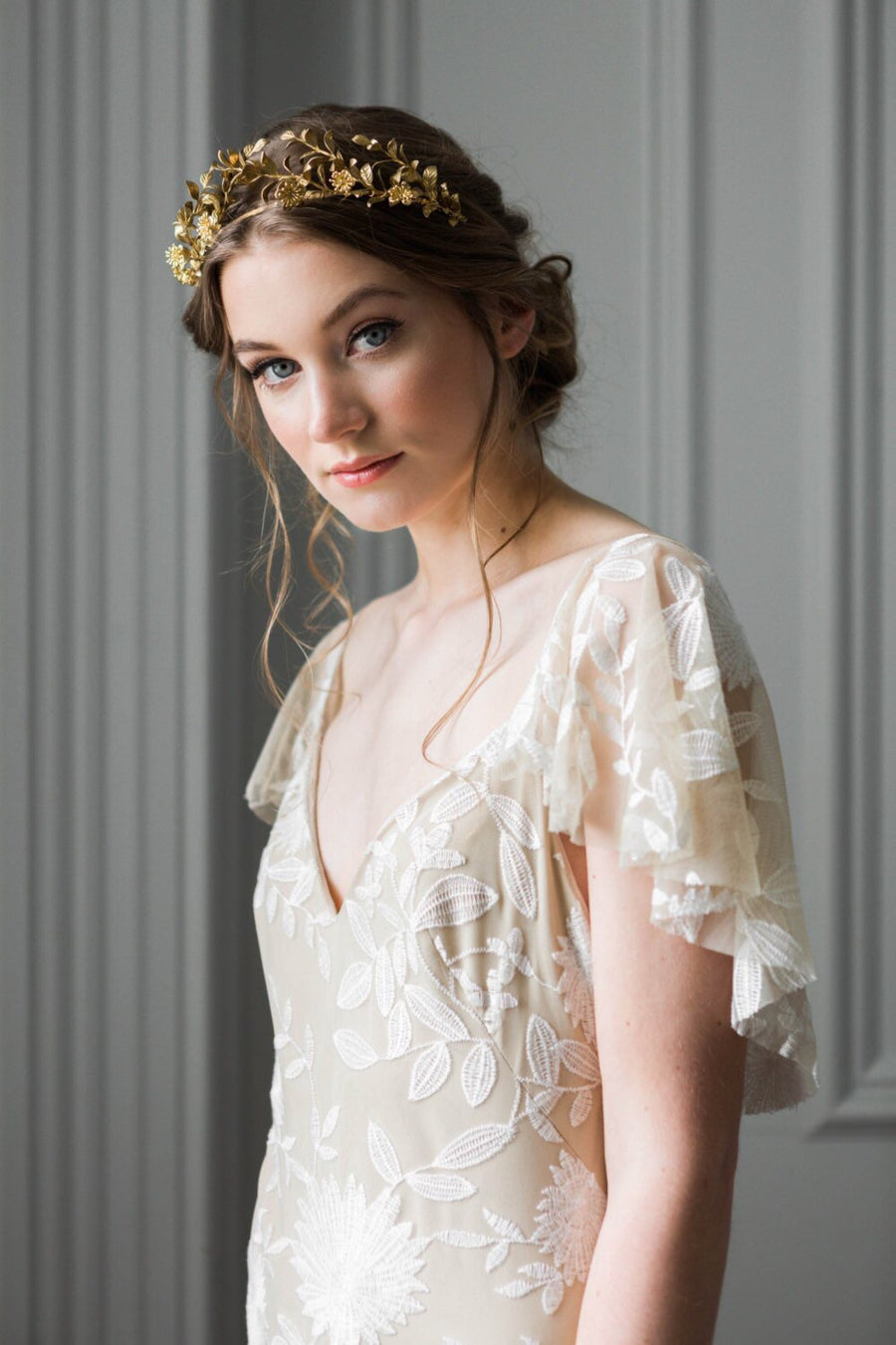 Bride wearing a gold headpiece made of replica anitque myrtle leaves