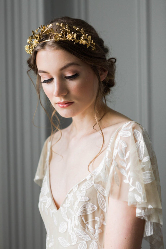 Bride wearing a gold headpice made replica antique myrtle leaves
