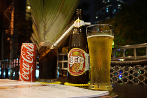 Drinking Coke and Leo Beer in Thailand