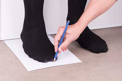 Drawing Outline of Foot with Pencil