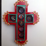 cross with bottle tops