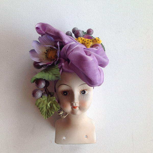 Ceramic doll; passionflower