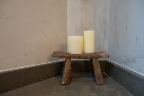 Wooden stool as candleholder