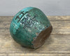 Antique green ginger jar with motifs