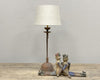 Table lamp made of iron candle holder with antique finish.