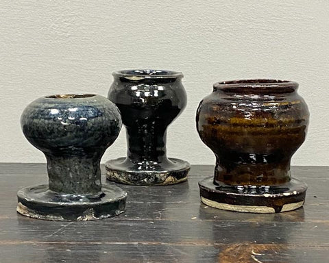 Small glazed wide footed pots