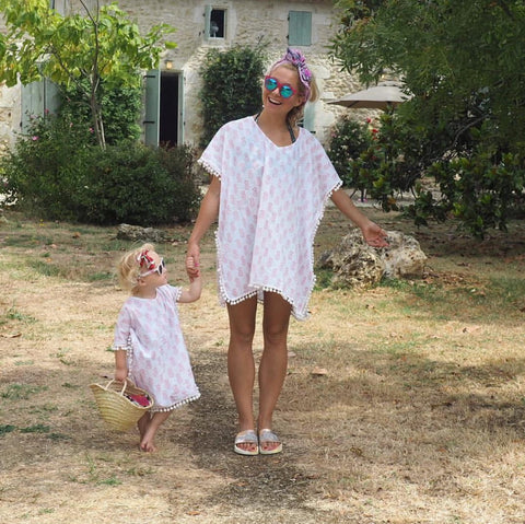 Mum and daughter wearing white and coral pineapple printed matching pom pom kaftans