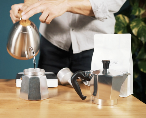 Pour hot water in Moka Pot