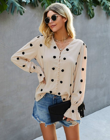 cream blouse with button up front