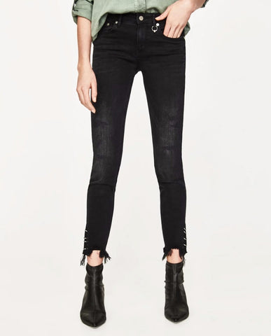 mid rise skinny jeans with metal grommets