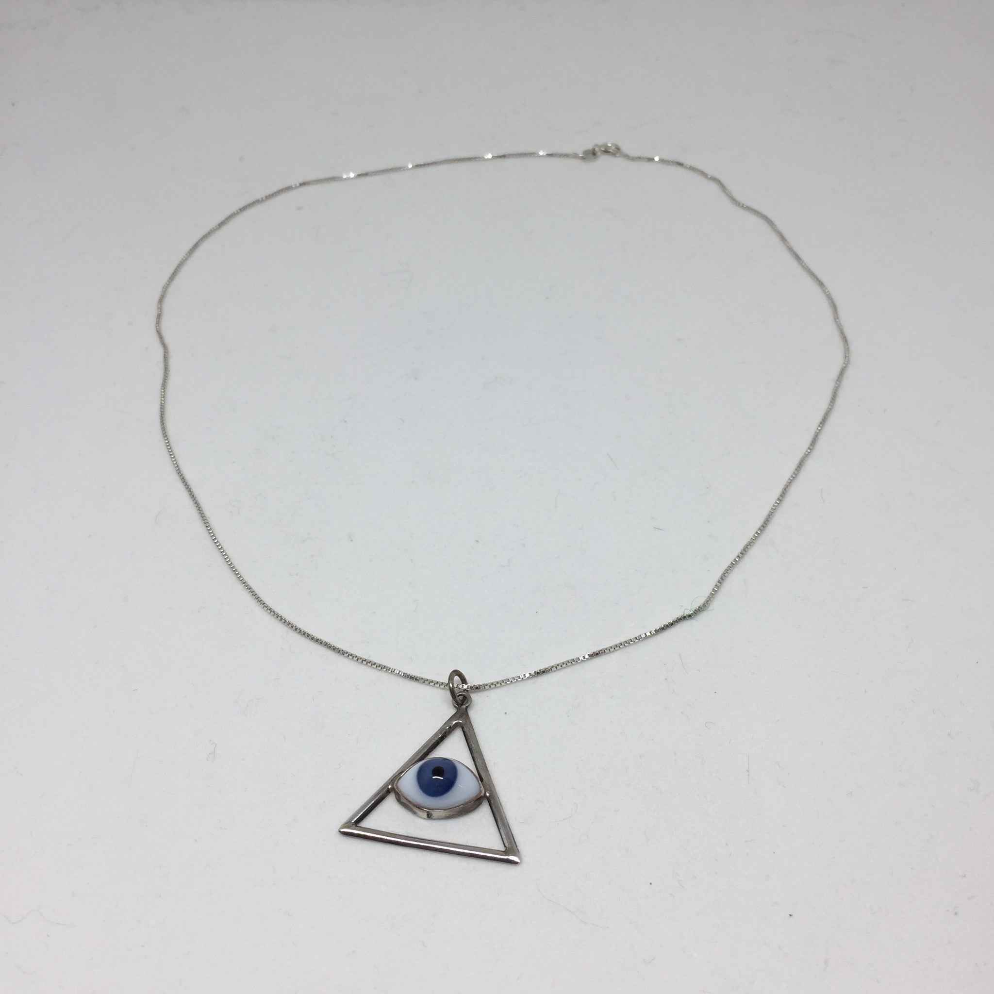 Evil Eye in Open Triangle Silver Pendant