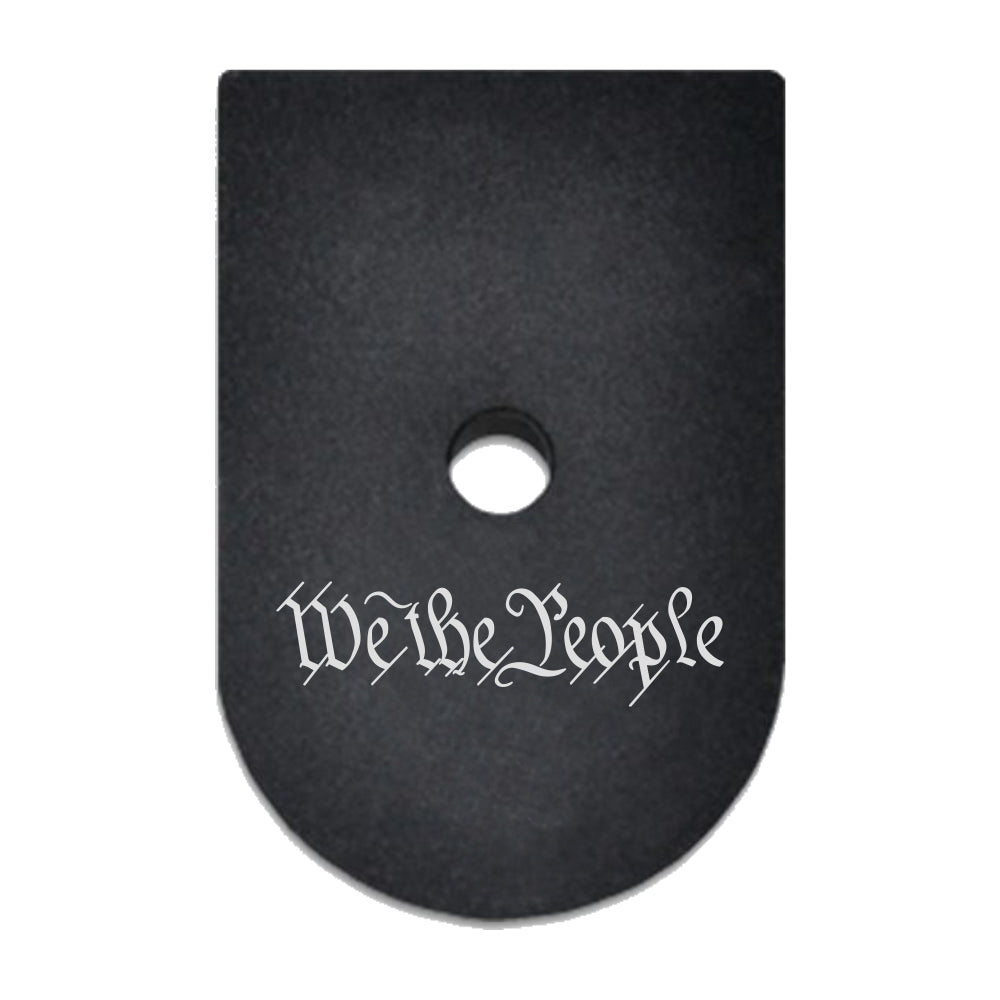 We The People Text laser engraved on a magazine base plate for Springfield XD 45 ACP