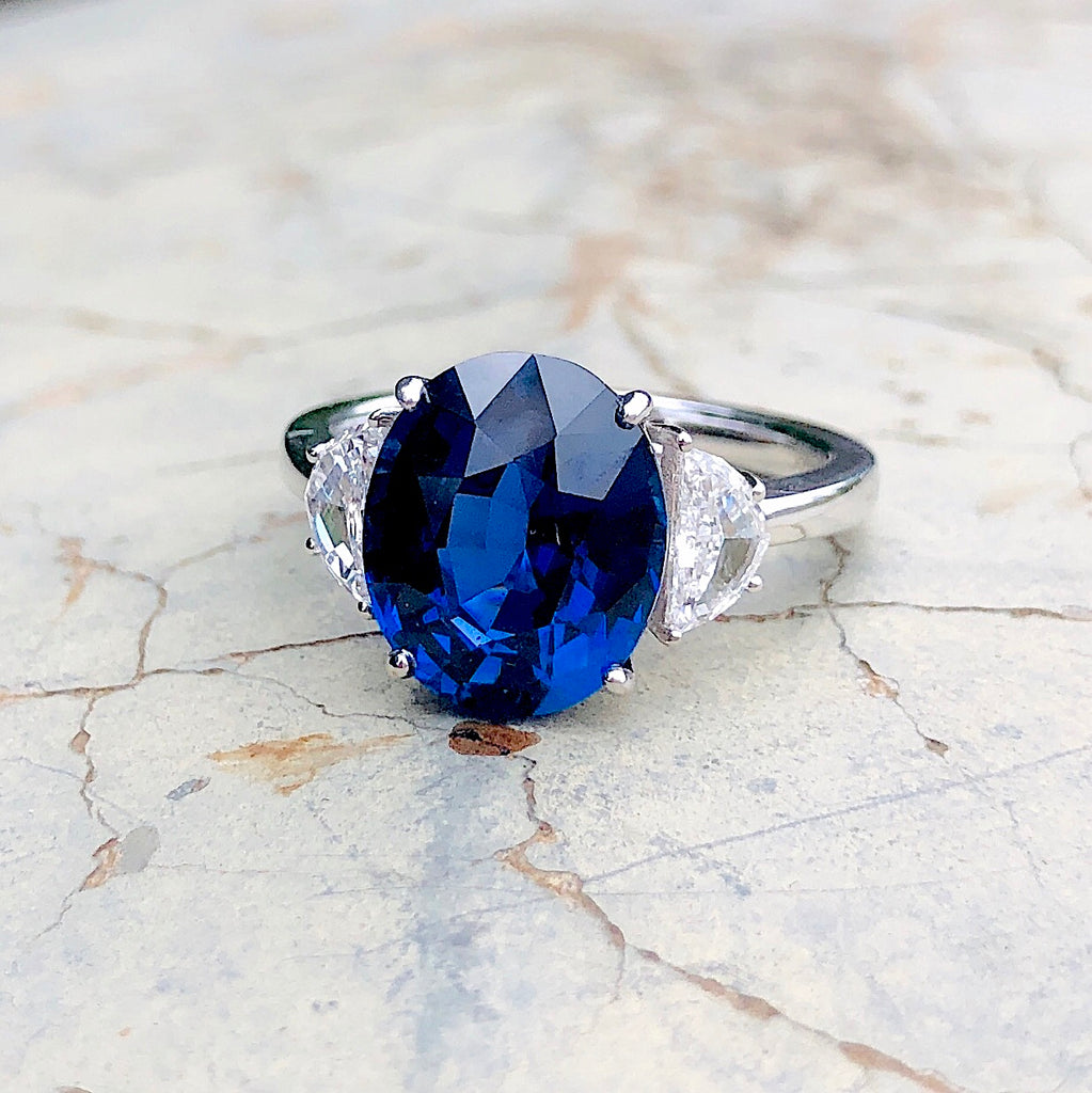 5.16CT Oval Ceylon Royal Blue Sapphire and Diamond Three-Stone Setting in 18k White Gold