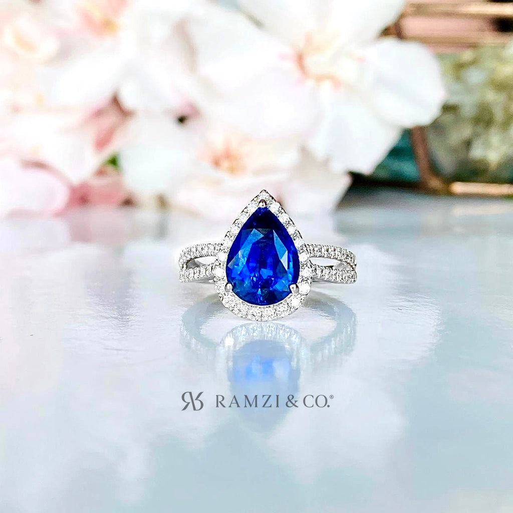 pear+shaped+royal+blue+sapphire+diamond+halo+engagement+ring+white+gold