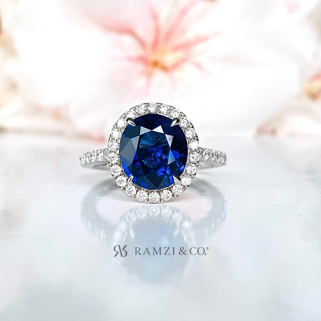 royal+blue+sapphire+halo+diamond+engagement+ring+white+gold