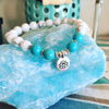 Bracelet 8mm magnesite/howlite with lotus charm
