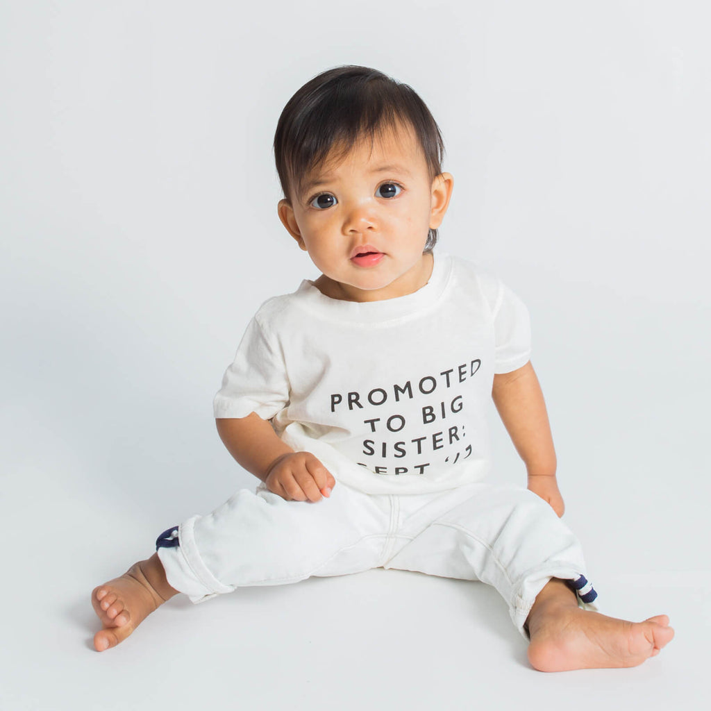 Baby wearing 'Promoted to Big Sis' custom tee