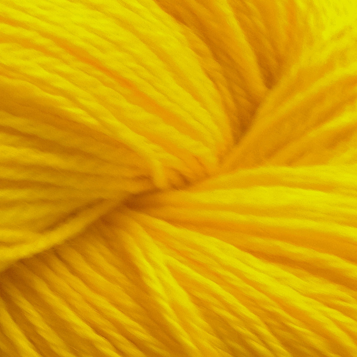 """Gold Dust"" is a bright burst of yellow in a kettle dyed sock yarn. Take this treasure and make something wonderful with it."